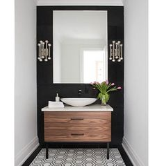 Black accent walls might not always be your first thought - but when it works, it's amazing! As we can see by this @jodierosendesign bathroom featuring a Frosty Carrina countertop. #powderroom #interiordesign Photo by Stephani Buchman.