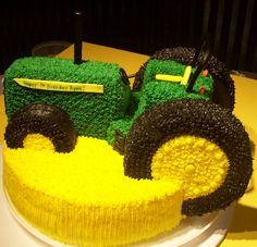 Tractor Cake for Reed's birthday....only it needs to be a Kubota!! (SUSIE....can you do this?!?!:))