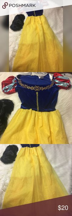 Snow White dress and wig Disney princess Snow White. Includes long floor length dress. Satin ruffled sleeved velvet blue top with gold details. Yellow type skirt with glitter throughout. In good shape. Includes black wig. Dress is a size medium Other