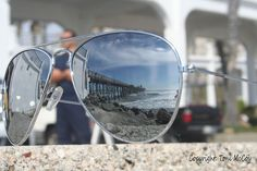 Oceanside Pier - Oceanside, CA.  Taken by me on 1-27-12.    The picture is kind of bright, but I like how the pier turned out in the reflection of the sunglasses.  I also like the firefighter standing in the background.