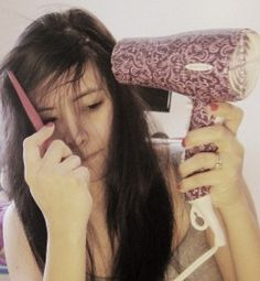 Blow drying bangs with a cowlick.