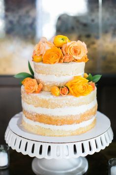 Pretty orange flowers: http://www.stylemepretty.com/living/2015/07/06/elegant-bistro-baby-shower/ | Photography: JL Photographers - http://jl-photographers.com/