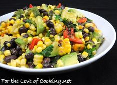 Grilled Corn, Poblano, and Black Bean Salad  Ingredients:  2 ears of corn, shucked  2 green onions  2 baby bell peppers  1 poblano pepper  1 avocado, diced  1/2 cup of fresh cilantro, chopped  Juice of one lime  1 tsp ground cumin  Sea salt and freshly cracked pepper, to taste  1/2 cup of black beans, drained & rinsed