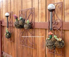 Plant succulents in hanging wicker balls to create awesome outdoor wall art.