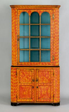 Exceptional Pennsylvania painted poplar two part corner cupboard, early 19th c.