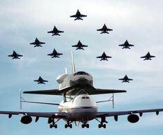 Space Shuttle Endeavour is escorted by 12 F/A-18F Super Hornets.