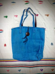Check out this item in my Etsy shop https://www.etsy.com/listing/250025993/blue-tote-market-bag-with-wooden-button