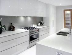 White cupboards, no handles, light grey splashback, all in one cooker Would prefer more colour White Kitchen Cupboards, White Gloss Kitchen, All White Kitchen, Kitchen Cabinets, Home Decor Kitchen, Kitchen Living, Kitchen Interior, Home Kitchens, Kitchen Ideas