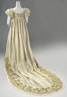 Court Dress c.1806-1810 To meet the strict requirements set by the court in Paris, a court gown had to be decorated with gold lamé (thin strips of gold). This gown – meant to be worn at the court of Louis Napoleon in the Netherlands – is worked 'merely' with gilt brass. The accompanying silk stockings and shoes are also on view in this gallery.(Rijksmuseum) Rijksmuseum