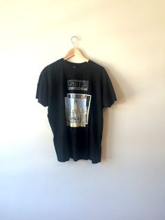 This is a vintage Led Zeppelin t-shirt for the album The Song Remains the Same. Material: 100% Cotton  SIze: Womens XL  Condition: Very Good