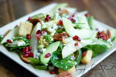 Winter Salad with a citrus vinaigrette: greens w/ pomegranate seeds, pear slices, pecans, avocado, cucumber and red onion