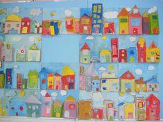 Een muur van huizen van papier en karton gemaakt door mijn leerlingen van het derde leerjaar!