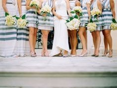 Unusual printed bridesmaids dresses in striped design are great for beach wedding themes