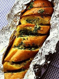 Garlic bread.French bread, 175gr(1 stick) butter softened,2 cloves of garlic, smashed and minces,1 tablespoon of chopper parsley. Preheat oven to 400°F (200°C).Make the butter, garlic, parsley mixture as above. Make thick slices into the bread, but do not go all the way through, just to the bottom crust.Put a teaspoon or two of the butter mixture between each slice and over the bread.Wrap the bread in aluminum foil and heat for 10'.Open and heat for 5'.Let cool a minute.Make thick slices.