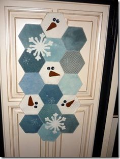We decided to do a blue, silver and white christmas this year, instead of the traditional red and white. I can't wait to make this Snowman table runner.