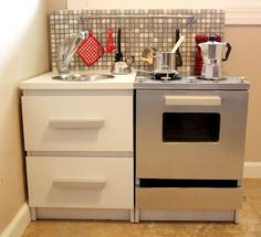 Materials: Malm chest with two drawersDescription: My husband transformed two Malm night stands destined for the dumpster into a modern, masculine play kitchen