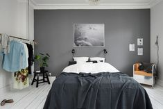 Bedroom with a grey wall - via cocolapinedesign.com
