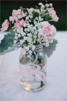 Mason jar flower arrangement with baby's breath and pink carnations. But with yellow carnations Carnation Centerpieces, Mason Jar Flower Arrangements, Mason Jar Flowers, Mason Jar Centerpieces, Wedding Flower Arrangements, Mason Jar Diy, Wedding Centerpieces, Wedding Table, Floral Arrangements
