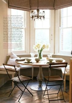 Built-in kitchen banquette. Interesting idea (might work in our kitchen). The window above the seating is great.