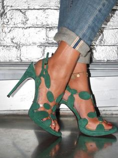 Emerald green will make you scream! Pair these cut out heels with those ripped, ragged, and slouchy boyfriend jeans and an oversized clutch. Intriguing details meet gold accents just below your ankle. So buckle up, because your stepping out.   Cesare Paciotti-Green sexy shoes