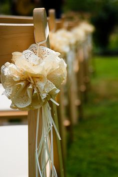 Lace chair decorations...mix with burlap and peach chiffon?