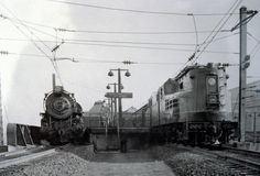 PRR ...Pennsylvania Railroad GG1 locomotive No. 4800 pauses early in its career, c. 1934, at Philadelphia's 30th Street Station, next to PRR K2 locomotive No. 3330.