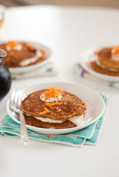 Decadent and delicious carrot cake pancakes made with whole wheat flour. Maple cream cheese topping! by Cookie and Kate!