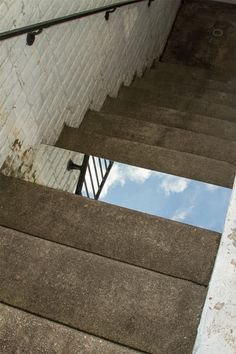 Mirror step. Custom made mirror fixed to a concrete step.