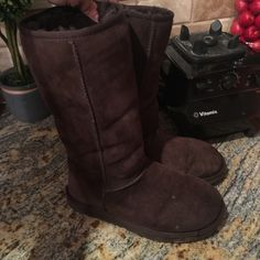 Tall brown uggs size 8 boots Worn but plenty of wear left! 100% authentic and size 8. UGG Shoes Winter & Rain Boots