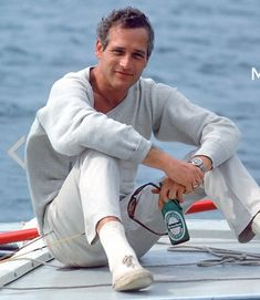 Paul Newman, looking very cool aboard a sailboat, circa 1960s