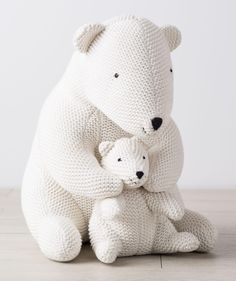 Mama and baby polar bear snuggle sweetly together. Adorable decor for every nursery. From Hallmark Baby.