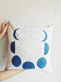 Moon Phases Pillow. I would make the background black, have the moons be white, and embroider gold stars on it
