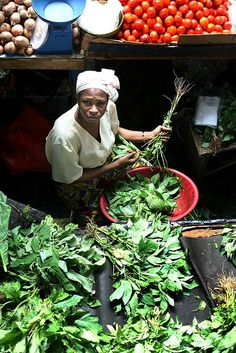 West Africa - Abidjan, Ivory Coast by babasteve, via Flickr:  Marketwoman selling potato leaves, an essential for sauce feuille, a local speciality.