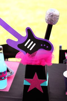 Bright & Girly Rockstar Birthday Party with pink candy apples, purple cupcakes, neon desserts, guitar centerpieces, cute party shirts and neon printables!