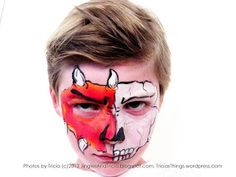 Face Painting idea for boys (or girls). Half face skull, half face monster / dragon.