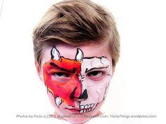Face Painting idea for boys (or girls). Half face skull, half face monster / dragon.
