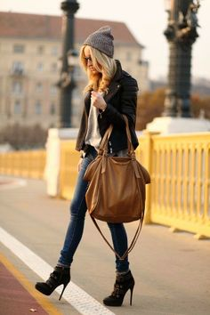 Grey stylish blouse with black stylish jacket and brown leather hand bag and blue casual plan jeans and black stylish high heels sandals and...