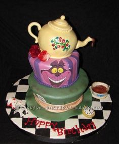 Coolest Alice in Wonderland Topsy Turvy Cake... This website is the Pinterest of birthday cake ideas