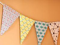 DIY Pennants! (http://cicadadaydream.blogspot.com/2010/01/tutorial-how-to-make-threaded-fabric.html)