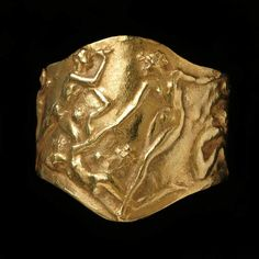 René Lalique. 1900-1920 Ring. Gold, cast with eight nudes in low relief. Fitzwilliam Museum Collections Explorer