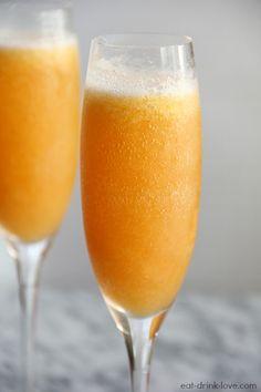 Peach Bellinis - 1 c frozen peaches, 1/4 c peach schnapps, 1 1/2 T sugar, 1 c ice, 1 c champagne or prosecco