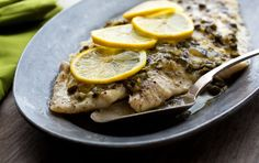 Oven-poached Pacific sole with lemon caper sauce. This fish recipe follows the Seafood Watch program recommendations.