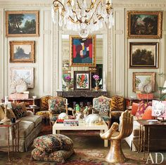 Jorge Elias Brazil living room, gallery wall, chandelier, hand chair, AD