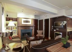 """The Heathman:  Grand Suite.  """"The room is large and airy and plushly furnished in browns and golds and beige . . . Holy crap.  I'm in the Heathman hotel . . . in a suite.""""  (Book 1, Chapter 5)"""
