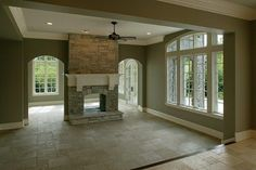 Two sided fireplace. I'd like that design for my living room/outside patio, different mantle.