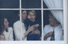 Prince George and nanny Maria Teresa Turrion Borrallo watch the Duke and Duchess of Cambridge leave for Trooping the Colour from a Buckingham Palace Window