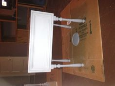 A drawer, stair spindles, and a cabinet front.. Equal one side table!