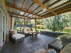 Corrugated iron roof with exposed beams More