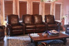 The couple that purchased this leather theater seating style sectional loved the western flare it gave their living room. #comfort #seating #for_the_home   Houston TX   Gallery Furniture  