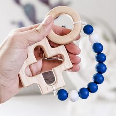 This teething rosary strand is handmade and the recipient was prayed for during its construction by the person that made it. It makes a perfect Baptism gift for a baby boy. The wooden cross and ring are made by a local Catholic artisan. They are cut from durable maple wood, sanded smooth, and finished with a baby safe and food grade mineral oil/beeswax blend. The beads used are FDA approved food grade silicone. Learn more about the bead safety. This item has been third party tested and meets the Catholic Baptism Gifts, Baby Boy Baptism Gifts, The Good Catholic, Baby Safe, Third Party, Christian Art, Mineral Oil, Shopping Mall, Food Grade